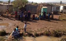 Children play in the water after a pipe burst in an informal settlement near Mamelodi. Picture: Shain Germaner/EWN