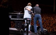 British singer-songwriter Elton John is helped off stage during a concert in Auckland, New Zealand on 16 February 2020. Picture: @eltonofficial/Twitter