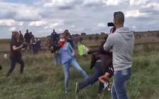A shocking video footage has been making rounds of a female journalist who tripped a man carrying his son while running from Hungarian police amid the refugee crisis.