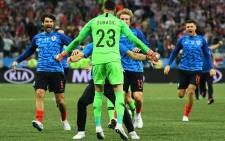 Croatia's goalkeeper Danijel Subasic celebrates with teammates after Croatia won the penalty shoot-out at the end of the Russia 2018 World Cup round of 16 football match between Croatia and Denmark at the Nizhny Novgorod Stadium in Nizhny Novgorod on 1 July, 2018. Picture: AFP.