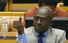 Malusi Gigaba waves his pinky finger during the question and answer session in Parliament on 6 November 2018. Picture: YouTube screengrab