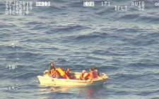 This video screengrab received from the New Zealand Defence Force on January 28, 2018 and taken from a Royal New Zealand Air Force P-3K2 Orion aircraft shows a five-metre dinghy adrift at sea in the Pacific Ocean with seven people on board, survivors from a ferry carrying 50 that was reported missing in Kiribati waters over a week ago. Picture: AFP.