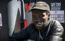 Sibongile Dyasi, a dustbin scavenger, has been surviving off what he finds in the dustbin for years. If a new recycling bylaw is passed, he will not be able to collect things like cans that have been thrown away. Picture: Kurt Orderson/EWN