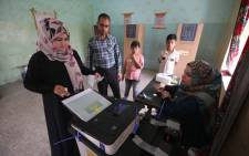 An Iraqi woman casts her vote at a polling station in the southern city of Basra on 12 May 2018. Picture: AFP.