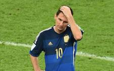 File: Argentina superstar Lionel Messi reacts after his side's defeat in the 2014 World Cup Final. Picture: AFP