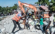 People look for survivors amongst the rubble in the neighbourhood of Dexia 6, Les Cayes, Haiti on August 15, 2021, after a 7.2-magnitude earthquake struck the southwest peninsula of the country. Picture: Reginald Louissaint JR/AFP