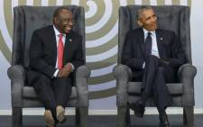 Former US President Barack Obama (right) and South African President Cyril Ramaphosa attend the 2018 Nelson Mandela Annual Lecture at the Wanderers cricket stadium in in Johannesburg on 17 July 2018. Picture: AFP.