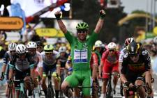 Stage winner Team Deceuninck Quickstep's Mark Cavendish of Great Britain wearing the best sprinter's green jersey celebrates as he crosses the finish line at the end of the 10th stage of the 108th edition of the Tour de France cycling race, 190 km between Albertville and Valence, on 6 July 2021. Picture: Philippe Lopez/AFP
