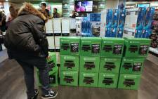 A man is about to buy the new XBox One game console on November 22, 2013 in Paris. Picture: AFP.