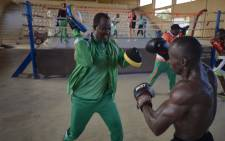 Coach Aziz Ousseini Doka (L) is seen while he's training one of his students during a training session in the municipal stadium of Niamey. Picture: AFP