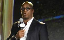 Former Arsenal and England forward and soccer analyst Ian Wright speaks onstage during a FOX Sports 2018 FIFA World Cup Celebration on 26 September 2017 at ArtBeam in New York City. Picture: AFP
