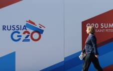 A woman walks past A G20 Summit billboard on 4 September 2013 a day before the G20 Summit begins in St Petersburg, Russia. Picture: AFP