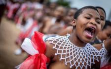 FILE: A traditionally clad Zulu maiden shouts as she takes part in the mini reed dance (uMkhosi woMhlanga) in the rural district of Emalangeni, some 80kms north of Durban on 19 August 2017. Picture: AFP