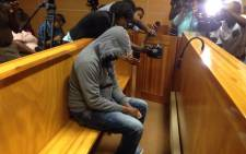 The 29-year-old truck driver, Amukulani Rikhotso from Giyani in Limpopo, in the dock during his court appearance on charges of negligence on 17 March 2015. Picture: Govan Whittles/EWN.