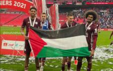 Leicester players Hamza Choudhury and Wesley Fofana pose with the Palestinian flag after their team won the FA Cup match Saturday, 15 May 2021. Picture: Twitter/@FC_Palestina