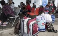 Nicaraguans wait next to their bags to present refuge requests at the migrations office in San Jose on 23 July 2018. Picture: AFP