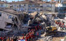 Rescue workers remove corpses from the rubble of a building after an earthquake in Elazig, eastern Turkey, on 26 January 2020. Picture: AFP