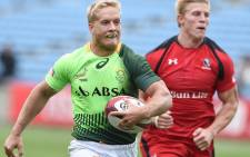 File: South Africa's Kyle Brown (L) runs in a try against Canada at the 2015 Tokyo Rugby Sevens. Picture: AFP