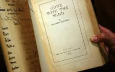 "In this file photo taken on October 18, 2007 a copy of the book ""Gone With the Wind"" by Margaret Mitchell, signed by producer, director, and most of speaking cast of the 1939 Hollywood film, is pictured in Los Angeles, California. Picture: AFP"