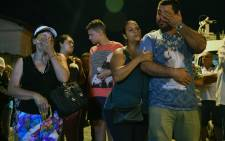 Locals attend a street mass nearby the Raul Brasil public school, following a shooting in which ten people -including the two shooters- died and 15 resulted injured, in Suzano, Sao Paulo metropolitan region, Brazil, on 13 March 2019. Picture: AFP