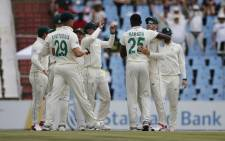 South Africa's Kagiso Rabada (3rd right) celebrates with his teammates after the dismissal of England's Dom Sibley during the second day of the first Test cricket match between South Africa and England at The SuperSport Park stadium at Centurion near Pretoria on 27 December 2019. Picture: AFP