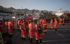Members of the Spanish Army Emergency Military Unit prepare to travel by boat from Tenerife to the island of Gran Canaria to participate in the extinction of a new forest fire in the town of Valleseco on 17 August 2019. Picture: AFP