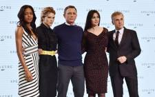 (L-R) British actress Naomi Harris, French actress Lea Seydoux, British actor Daniel Craig, Italian actress Monica Bellucci and Austrian actor Christoph Waltz pose during an event to launch the 24th James Bond film 'Spectre' at Pinewood Studios at Iver Heath in Buckinghamshire, west of London, on 4 December, 2014. Picture: AFP.