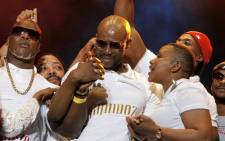Kwaito star Mandoza is supported by his wife Mpho as he addresses the crowd at Orlando Stadium concert. Picture: Facebook.