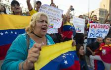 Venezuelans living in Peru take part in a rally in support of Venezualan opposition leader and self-declared acting president Juan Guaido in Lima on 1 May 2019. Picture: AFP