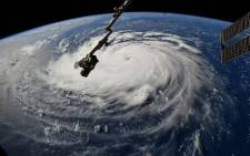 FILE: This Nasa handout photo shows a view from the International Space Station of Hurricane Florence off the US east coast in the Atantic Ocean on 10 September 2018. Picture: AFP