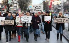 Women hold signs reading 'We are no fair game' to protest against violence against women in Hamburg, northern Germany, on 10 January 2016. Picture: AFP.