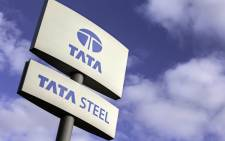 """FILE: A signboard at the Tata Steel plant is pictured in Scunthorpe, in north east England on October 17, 2015. Picture: AFP."""""""