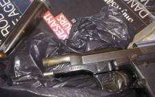 Langa police arrested a 27-year-old foreign national who runs a shop in the Joe Slovo informal settlement for possession of an unlicensed firearm and ammunition. Picture: SAPS