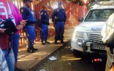 Police were called maintain calm at the Roodepoort School following parents protest outside the school on 18 August 2015. Picture: Ziyanda Ngcobo/EWN.