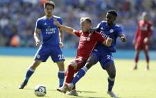 Liverpool's Swiss midfielder Xherdan Shaqiri (L) is tackled by Leicester City's Nigerian midfielder Wilfred Ndidi during the English Premier League football match between Leicester City and Liverpool at King Power Stadium in Leicester, central England on 1 September 2018. Picture: AFP.