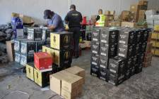 Cape Town police arrested four suspects after they were nabbed for buying and selling alcohol during the lockdown on 14 May 2020. Picture: @SAPoliceService/Twitter