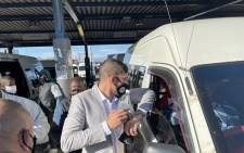MEC Daylin Mitchell visited the Khayelitsha taxi rank together with Santaco on 7 July 2021 to raise awareness and encouraged minibus taxi users to follow the golden rules of hygiene for keeping safe and complying with Alert level 4 regulations. Picture: Daylin Mitchell/Twitter