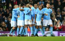 Premier League leaders Manchester City players celebrate their victory over Bournemouth. Picture: @ManCity/Twitter.