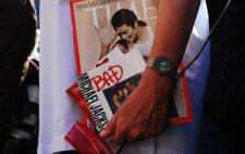 A Michael Jackson fan holds a copy of Time magazine with their idol on the cover at the Nelson Mandela Square in Sandton on 03 July, 2009. Picture: Taurai Maduna/Eyewitness News