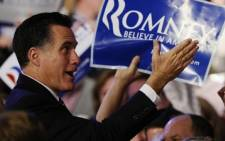 Republican presidential hopeful Mitt Romney greets supporters in New Hampshire. Picture: AFP