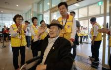 Participant Kim Bong-eoh arrives at a hotel and gathering point ahead of the inter-Korean family reunion in Sokcho on 19 August, 2018. Picture: AFP.