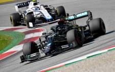 Mercedes' driver Lewis Hamilton ahead of Williams driver Nicholas Latifi during the Austrian Formula One Grand Prix race on 5 July 2020 in Spielberg, Austria. Picture: AFP