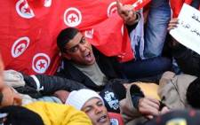 Inhabitants of the central Tunisia region of Sidi Bouzid chant slogans during a demonstration in front of the Government palace in Tunis. Picture: AFP.