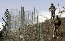 FILE: Indian soldiers patrol along a barbed-wire fence near Baras Post on the Line of Control between Pakistan and India. Picture: AFP.