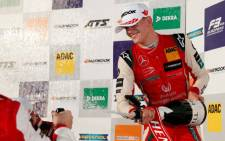 Germany's Mick Schumacher of Prema Theodore Racing celebrates with champagne on the podium after winning the Formula 3 European title on Germany's Hockenheim circuit on October 13, 2018. Picture: AFP.