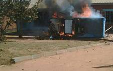 Demonstrators in Mzuzu allegedly torched this vehicle belonging to the ruling DPP. Picture: Malawi Voice