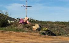 A cross erected at Witsands in memory of a surfer who was murdered. Picture: Brenton Geach