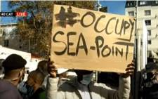 A group of residents opposed to the auctioning of SABC buildings in Cape Town are protesting on 20 May 2021. Picture: SABC Digital News/ YouTube screengrab.