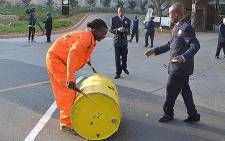Greenpeace activist beats a drum in demonstration outside the IDC offices in Sandton.Picture: Tshepo Lesole/EWN