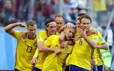 Sweden players celebrate their victory over Switzerland during their round of 16 match. Picture: Facebook.com.
